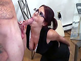 Lavender is hard at work on the computer when her man comes in looking for some action.  She eagerly stops what she is doing to drop to her knees and suck his cock.  After slurping schlong, Lavender bounces up and down on his cock in her pierced and shaved pussy.  She finishes him off by sucking his