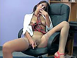 Lavender plays the part of the naughty schoolgirl in this scene.  She is in an office chair and begins to play with herself.  She rubs her shaved and pierced pussy, and then shoves pencils in her wet hole.