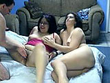In this scene, amateur girls Lulu and River get started with each other, and are then joined by a hairy, geeky guy.  They share his dick and lick each others pussy while the other is sucking.  He fucks them both and blows his load in the condom.