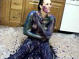 In this scene, amateur girl Halley is playing in the kitchen.  She is on a sheet of plastic and covering herself in what looks to be colored cottage cheese.  She then pours syrup all over her body.