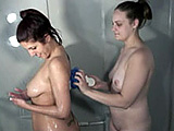 In this scene, amateur Lavender is in the shower, soaping herself up.  She is joined by Danni, who takes over the soaping duties.  Lavender then rubs down Danni with the loofa.