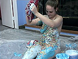 In this amateur scene, Danni gets naked on plastic in the middle of the floor.  She covers herself in colored cool whip, sugar, and fruit loops.