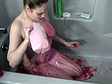 This scene features amateur Danni standing in the shower.  She doesn't turn on the water, but she covers herself in red syrup and strawberry milk.
