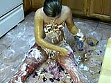 This one if or all you messy fans.  Naomi St Claire is solo in the kitchen for this scene.  She is on the floor and covers herself in peanut butter and jelly.  Naomi puts on a topping of whipped cream just for good measure.
