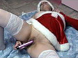 In this amateur scene, Danni is dressed up as a slutty Mrs Claus.  She rubs her shaved pussy with a vibrator and stuffs it in her holiday hole.  Danni doesn't need Santa; she already is a ho.