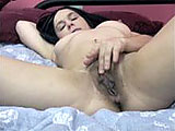This scene is amateur girl Sarah on a bed masturbating.  She rubs her pussy through her panties first, and then plays with her nipples; tweaking and licking them.  Next, she gets out of her panties and directly stimulated her clit.    Sarah finger bangs her pussy and even throws a finger in her ass