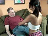 In this scene, Lavender is dressed up as a slutty schoolgirl.  She gives a lucky, hairy guy a blowjob and then rides his dick on the couch.  He fucks her from behind and finishes in mish before blowing his load in the condom.