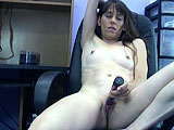 In this scene, Samantha Charles is in an office.  She is on the desk and playing with her purple vibrator.  Samantha works the vibrator on her clit until she achieves liftoff.