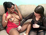 In this scene, Liani gets with Vixen the midget.  Vixen starts by rubbing a vibrator on her black pussy, and then works it in and out of her hole.  Now Vixen gets her turn as Liani shoves a pink dildo in and out of her.
