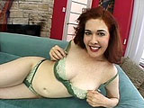 Busty and mature redhead, Mae Victoria is showing off all her curves and masturbating her hairy pussy.  She gets her holes ready with fingers and a dildo.  A guy comes in and takes over fucking her ass with the dildo while she rubs her clit.  She keeps the toy in her ass while sucking and licking di