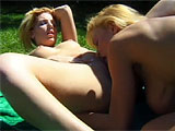 Tanya Danielle is doing some topless sunning while Heaven Leigh watches from the bushes.  She eventually approaches and the two get it on out in the grass.  Heaven goes down on Tanya and works a vibrator in and out of her wet snatch.  They switch positions, but Heaven stuffs a vibrator up her own as