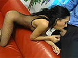 A businessman comes home to an exotic beauty on the couch wearing an easy access fishnet bodysuit that is crotch-less.  He plays with her hot body a bit before she pulls out his cock to feed on.  He fills all of her holes in many different positions and then blows a healthy load all over her face.