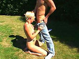 Simone Claire poses a bit outside before being joined by a guy.  He eats her ass and fingers her holes before she pulls out his cock and sucks it down deep in her throat.  The guy pounds her bald pussy and ass out on the grassy knoll, and she sucks her juices from his cock.  Simone takes his load in