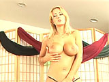 For this scene, Trina Michaels does a sexy striptease and then sucks a mean dick.  Trina takes the guys load in her mouth and then lets it dribble out on to her beautiful tits.