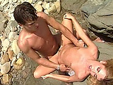 Sexy little blonde Allysin Chaynes is working on her cock riding skills on the rocky part of the beach. She starts on her knees, pulling out the guy's cock for a throat fucking. Next, she lies down on a big rock to receive a cocking. The stud finally yanks his Johnson out after fucking her for som