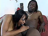 Carmen Hayes slurps on her man's big black cock, getting it good and hard.  They fuck in various positions on the bed and the guy drops his jizz all over Carmen's big ole titties.