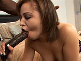 In this scene, Tia Sweets is a not so sweet little girl sucking on a lollipop and shoving it in and out of her tight pussy.  She is joined on the bed by a black guy and she teases his cock before sucking it down her throat.  She takes his big cock in her tight shaved pussy and it looks like it might