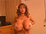 Minka is an Asian hottie with old school style. In her ladylike striptease, she slips out of her silky robe and shows you a set of tits that are impossibly immense. Her body is petite, but the cans are gargantuan. During her striptease, she sits down to smoke a cigarette, then gets back to business,