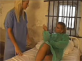 In this scene, Misty Mild is in prison and seduces her nurse.  These two get it on in the prison cell bed, eating and fingering each other's pink holes.  They go cunt to cunt with a double ended dildo and finish each other off by shoving the toy in and out of their sloppy holes.