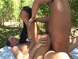 A photo shoot turns sexy in an outdoor setting, when the beautiful Asian girl gets all horned up by her male counterpart. He strips her naked and uses two fingers to get her pussy juiced up and ready for cock. As he pounds her from behind, the camera guy joins in, slipping his hard pole into her mou