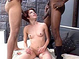 This scene opens to sexy brunette Capri blowing on two beefy black cocks. She continues blowing one of the guys as the other tags her tight pussy from behind.  After some anal penetration, both dudes drop nut bombs on her face.