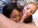 Black temptress Marie Luv and sexy white slut Angela Stone are dressed in fishnet outfits which show off their firm, round asses. After having their assets inspected, the two whores pile on top of one another, so the guy can have easy access to both vaginas. He begins by fucking the black ho before