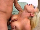 Sexy blonde, Adrianna Nicole, is getting her ass fucked. She gets the guy warmed up with a good titty fucking before she gets her ass pounded in a number of positions.