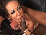Busty brunette, Angelica Lauren takes on a black stud in this scene.  She starts off sucking his cock on the couch, before he slips it in her shaved slot.  Angelica gets it deep in her pussy and sucks her juices off the chocolate log.  He titty fucks her large melons and drops his load all over them