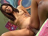 In this scene, Kammy is a Japanese chick that is a bit timid about the big black cock unleashed on her.  She sucks this guy's cock and he eats her shaved pussy.  He sticks it in her tight asian hole and has her suck her juices of his cock in between positions.  She hops off his cock to take a cums