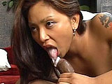 In this scene, a black guy comes in to the room and starts licking Finesse Navarro's pussy.  She returns the favor with a sloppy blowjob, and then he stuffs his big black cock in to her tight asian pussy.  They fuck in several positions and then she skillfully sucks out his load directly in to her