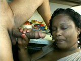 This big black girl is fucking a big dick with her mouth. To give her mouth a break, she sandwiches the dude's cock in between her massive melons for a titty fucking.