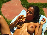 For this scene, and Taylee and Rikki get it on outside on a blanket.  Taylee is the first to go downtown and eats Rikki's fur burger.   She gets her turn as Rikki licks at her shaved and pierced pussy while she eats a banana.
