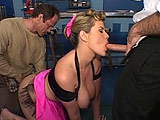 Top heavy Lisa Sparxxx invites two dudes to pump away at her holes. One guy munches on her muff while she caresses the other's cock with her tongue. She goes back and forth blowing both of them.  The guys go back and forth penetrating her until they both explode all over her big boobs.