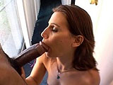 This sexy brunette wasn't going to wait for cock. She starts blowing the first big black cock she sees.