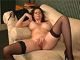 June Summers is older, but still sexy and sweet. She puts on a strip tease, revealing excellent tits and a body that's aging well. She relaxes on the couch and parts her long legs to show off her bald, wet snatch. She teases it a bit and then fingers herself long enough to pull out some pussy juic