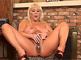 When Kandi Cox is done with a hard days work, she likes to come home and strip out of those censoring clothes.  She realeases her whopping boobs from their confines and gets busy working over her vag.  She lubes it up and buzzes her button with a vibrator, and slides it in and out until she releases