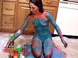 Summer Tyme is in the kitchen for this messy scene.  She covers her body in Egg-Nog, oatmeal, and corn syrup.