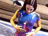 This amateur scene is another messy.  Summer strips down naked and gets on a sheet of plastic.  She covers her body in various colored paints before showering off.