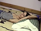 In this scene, Tawny ties Roxanne s hands above her head and to the bed.  She then strips her naked and drips hot candle wax all over her body.  Tawny works the lit candle in and out of Roxannes shaved pussy.  