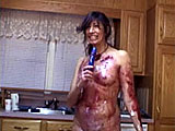 This is Tawny's first messy. She is in the kitchen with blueberry pies and whipped cream.  She rubs the pies all over her naked body, taking a few bites along the way.  Next she sprays whipped cream all over. Tawny gets out a vibrator and lubes it up with the pie filling before stuffing it in and