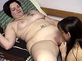 Watch Christina get licked and finger fucked by an eager older chick. Comely Christina's slit gets slippery when her experienced friend nails her with a dildo. They finish up with a face sitting session, with fantastic shots of Christina's big ass.