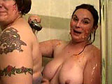 Giggly girlfriends shower together, spraying and soaping each other's buxom boobs and booties. Later one girl showers alone, sliding her sudsy hands all over her tits and pussy. Before it's all over, she turns around to show the camera her big, bouncy ass.