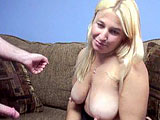 A salty blonde whore licks and sucks Logan's knob in several positions. She pulls him hard into her gullet over and over, while he moans. Finally he releases a wad, most of which she drinks, but a little dribbles down her chin.