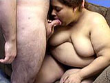 In this amateur scene, Nikki is the large and in charge chick.  She gives the hairy geek a blowjob and he nuts all over her tongue stud.