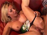 A dorky goon gets lucky with an older, but knock out blonde. They hook up on a red leather couch, first with her exploring his crotchal region through his zipper, and then swallowing his shaft deep and gargly. He laps up her ample but sweet looking twat and clit, then settles her right down on his j