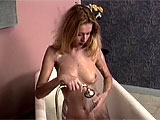 In this two for one compilation scene, you get the pleasure of watching two lovely blondes cleanse themselves in the tub. First, a big boobied blondie slips into the water, gets wet and then fingers her slot while diddling her clit. The next scene shows a slender lady, preparing her douche bottle an