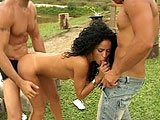 Paula Moreno is the featured whore in this scene.  She is wearing only a cook's apron at her picnic with two guys.  She sucks these two hotdogs in a double blowjob and takes them deep in all of her holes.  These guys brought a special sauce for her to taste at this picnic, and they squirt it in he