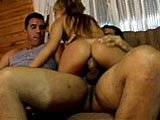 Here is a blonde with two guys on a couch talking in their native Latin tongue.  It appears that they are talking her into a threeway.  It doesnt take much convincing, as she is soon undressed and sucking down their cocks.  She bounces up and down on their meat for a while, and then they DP her a