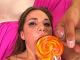 Sexy young Amanda West is getting fucked by a big dick. Before licking the dude's cum off her lollipop, she sucks and rides her way to that stomach full of jizz.