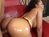 Donna Red gets all oiled up as she shakes her big black booty.  She sucks huge black cock and her tight pink hole is stuffed full.  Donna squeezes out a fresh Creampie for all to see.